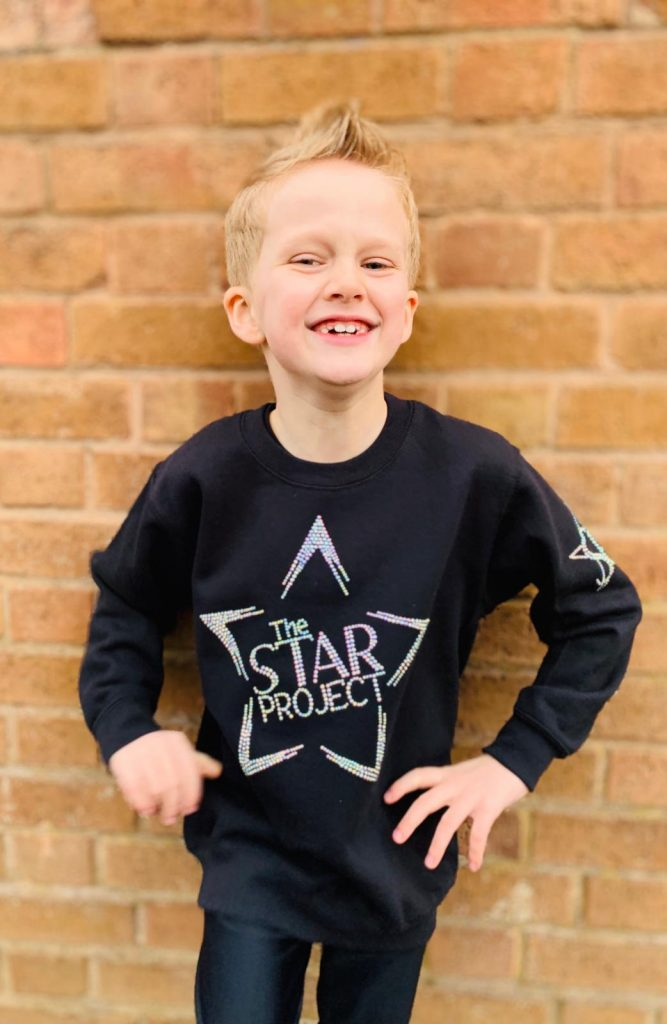 Star Project student happy because his Mum has added all the term dates to her dairy